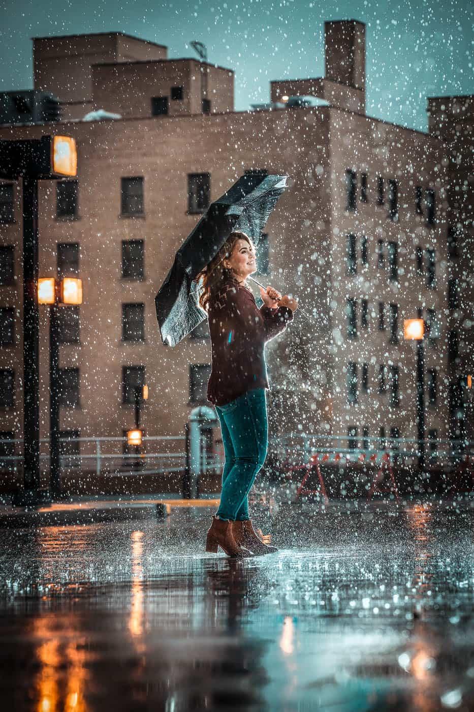 Senior girl in the rain with an umbrella