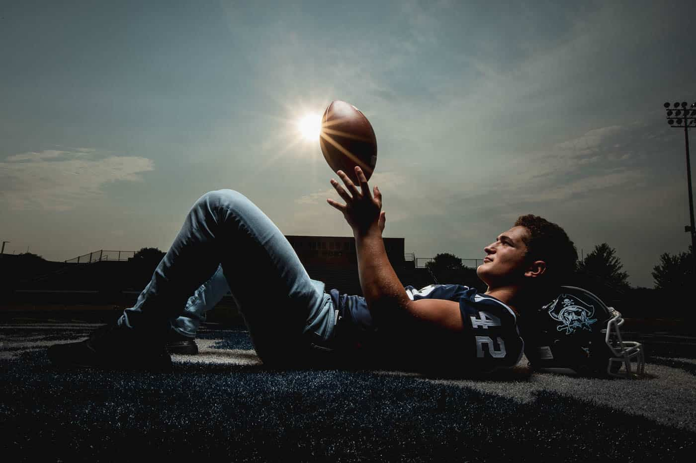 Football Senior Pictures. Lying on school field for pictures